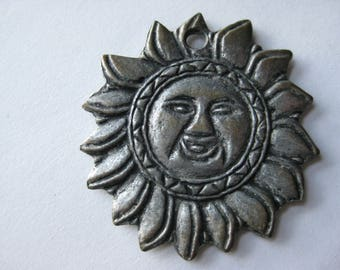 two sided sun pendant