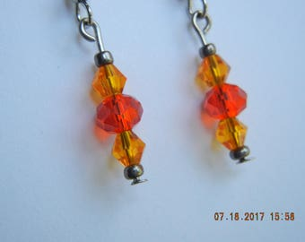 Orange and red glass bead earrings
