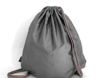 Silver waterproof drawstring bag backpack with lining and zipper pocket Unique