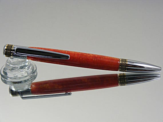 Knurled Twist Ink Pen in Chrome with gold accents and Golden Red Acrylic