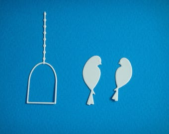 Cut, swing and a couple of birds to create white drawing paper
