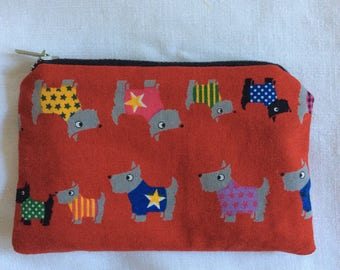 Small purse dogs on red background