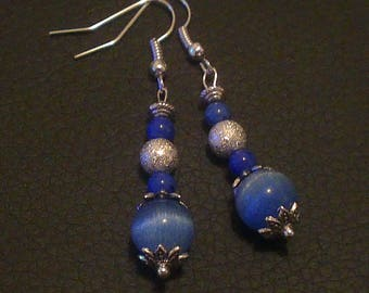 Matching bracelet earrings all in blues and silver glitter