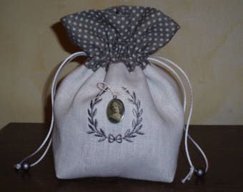 White cotton linen bag grey with white polka dots adorned with a vintage pendant