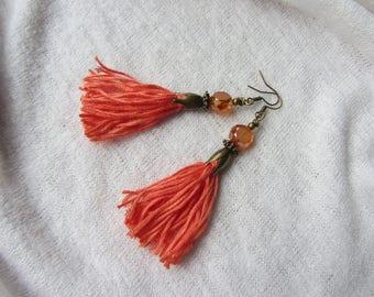 Bohemian, boho earrings, dangle earrings, coral tassel, faceted glass beads, bronze Cap