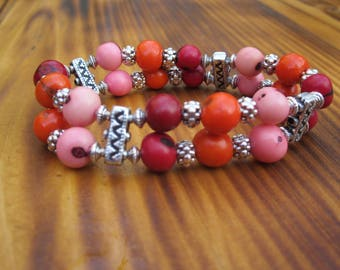 Bracelet in pink and silver finishes Acai seeds