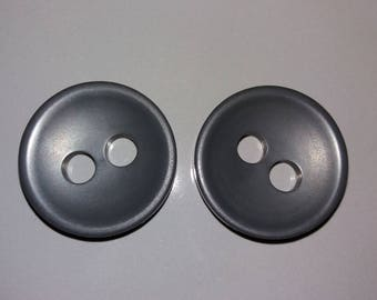 Two large grey buttons