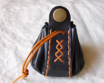 Coin purse is orange-black leather hand stitched