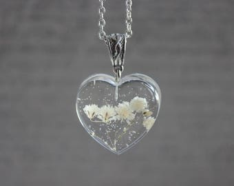 Necklace 62 cm + pendant 3 cm white inclusion of dried baby's breath flowers and resin heart