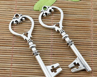 stylized X 2 metal heart key silver 64 x 20 mm approximately.