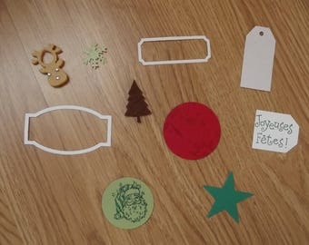 Set of 10 Christmas scrapbooking embellishments.