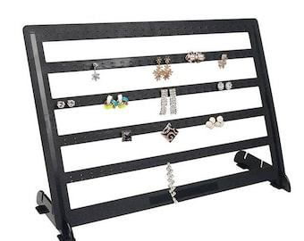 removable and positionable earring holder wish 240 holes within 15 days