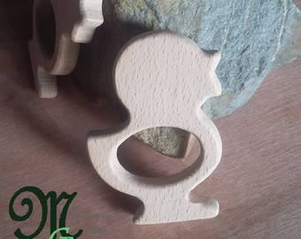 Natural wooden teething ring. Chick shape.