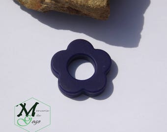 Teething ring. Dark blue flower shape.