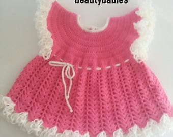 Pink ruffled dress size 3 to 6 months