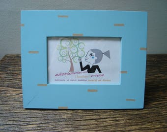 beige dotted blue picture frame