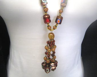 Venetian glass, mosaic with gold accents. Murano flapperketting. ca. 1950