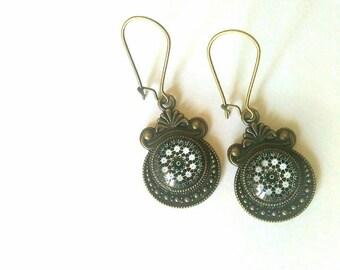 Pair of bronze stud earrings. Black and white Mandala pattern.