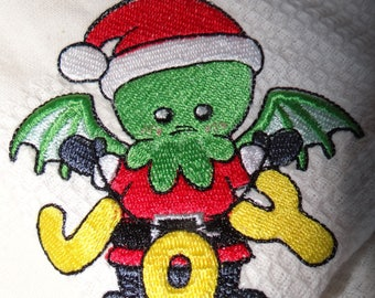 Large tea towel embroidered with a monster Christmas