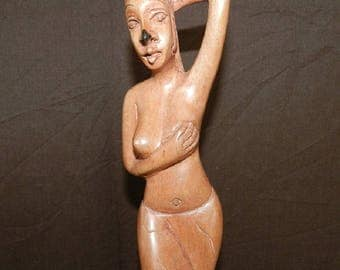 Woman topless ebony sculpture from Africa. Height 35 cm