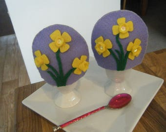 A pair of Handmade Daffodil Egg Cosies
