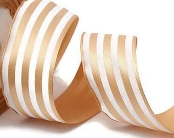 Satin ribbon has beige & white stripes