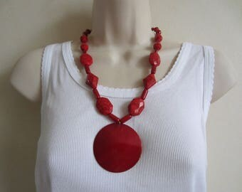 Red necklace with mother of Pearl pendant