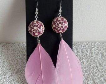 Pink earrings with feather