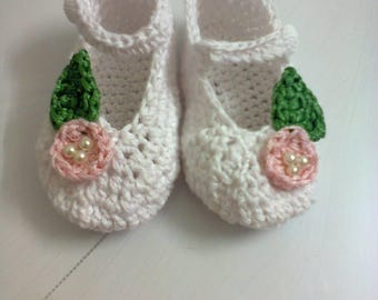 White with pink baby shoes with crochet flowers