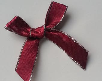 Red and silver satin ribbon bow