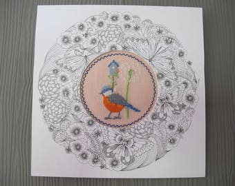 Painting of a bird, birdhouse and dandelion embroidered