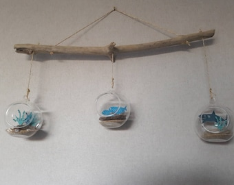 Hanging glass baubles in shark fish seaweed