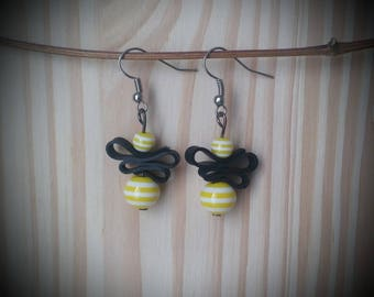 Striped resin - yellow beads and recycled bike tube earrings