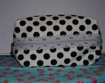 White clutch with black dots
