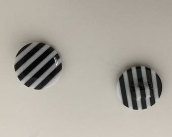 Black white striped button on foot