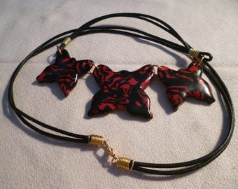 Butterfly polymer clay necklace.