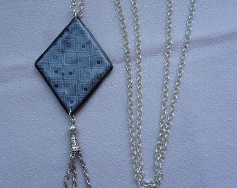 Long necklace with polymer clay pendant.