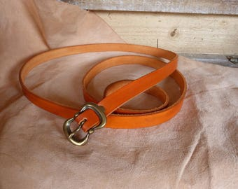 Pretty thin orange leather belt buckle