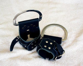 a pair of small size leather suspension cuffs