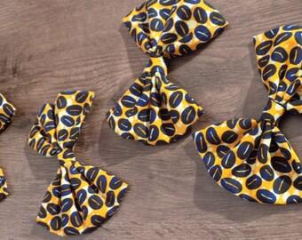 4 large wax yellow/blue/black/orange bow.