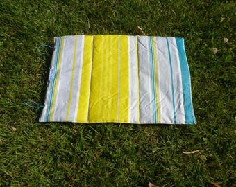 Gray, yellow and turquoise to carry around colorful hiking cushion