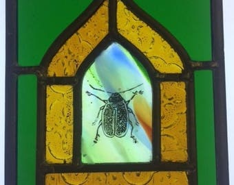 Mini stained glass window with hand painted beetle