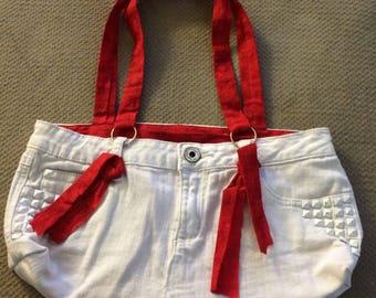 Handmade White Jean handbag with red interior.