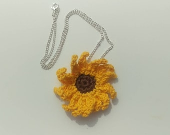 A beautifully handmade crocheted sunflower style necklace