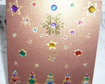 Greeting card for the holiday season stars and trees Brown metallic with matching envelope