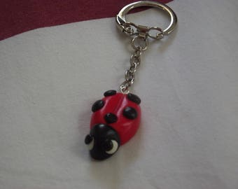 Key ring with red and black Ladybug