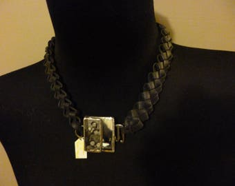 A crew-neck sweater necklace with pendant
