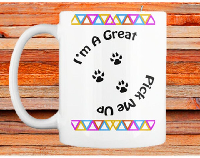 "Coffee Mug: ""I'm a great pick me up;"" Paw print coffee mug; Available in white only"