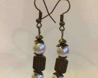 Bronze earrings with ivory pearls