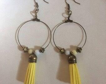 Bronze hoop earrings with yellow tassels